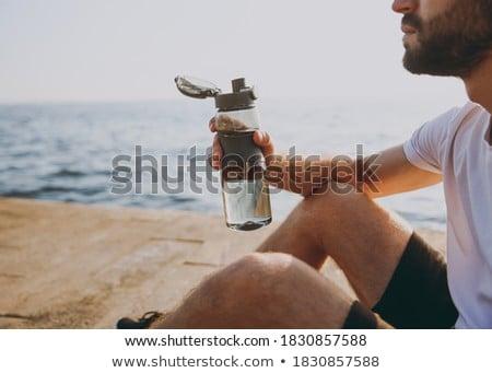 homem · água · potável · garrafa · praia · paisagem · moço - foto stock © juniart