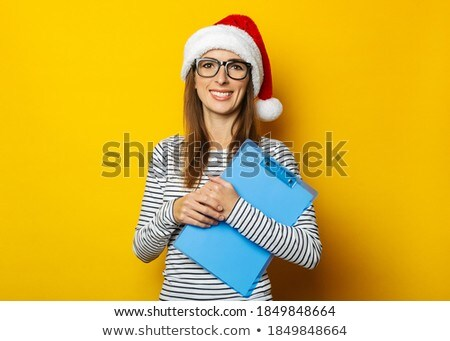 Stock photo: Young woman surprised at her clipboard
