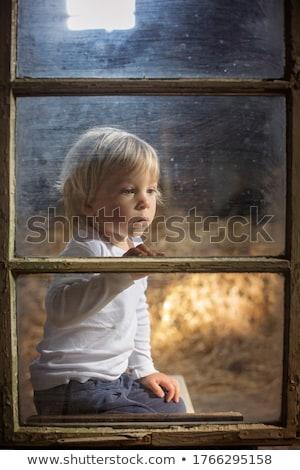 Playful young blonde Stock photo © acidgrey