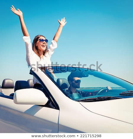 Happy couple enjoying with their arms outstreched stock photo © get4net
