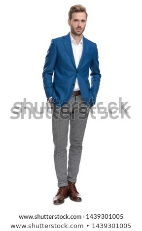 Businessman standing with his hands in pockets and smiling Stock photo © imagedb