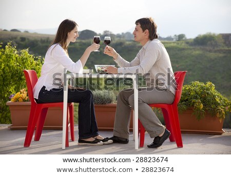 Man and woman having drink in country Stock photo © IS2
