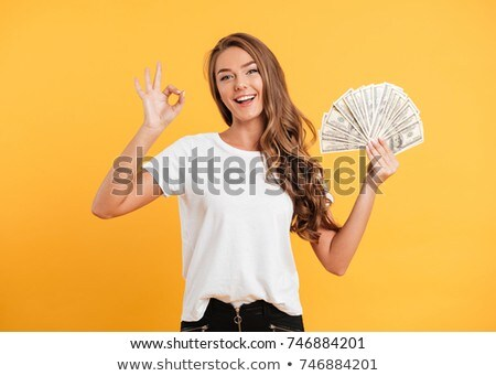 Portrait of an excited young girl showing ok gesture Stock photo © deandrobot
