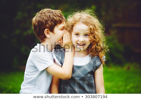 Pequeno menino menina segredo sorrir escolas Foto stock © Lopolo