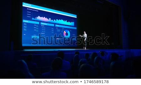 Woman at Big Digital Screen Shows Presentation Stock photo © robuart
