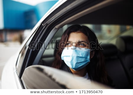 Coronavirus, quarantine and pandemic disease concept. Sideways shot of European man wears shades and Stock photo © vkstudio