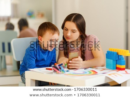 Preschool boys playing with educational toys - blocks, train, railroad, vehicles at home or daycare. Stock photo © Len44ik