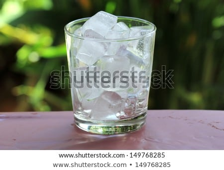 A glass with ice cubes Stock photo © ozaiachin