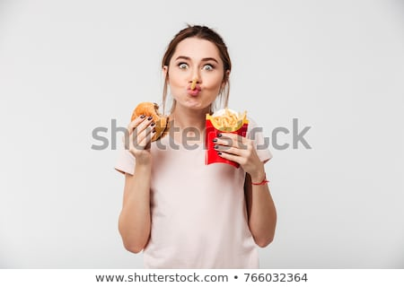 Young girl eating fries Stock photo © photography33
