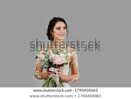 woman in a beautiful gown is looking to her side Stock photo © feedough