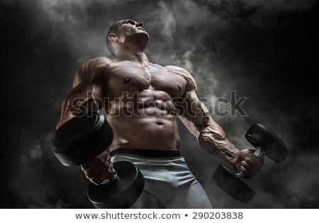 muscular man posing stock photo © deandrobot