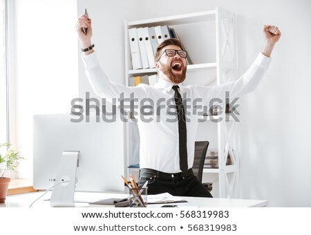 young caucasian happy businessman gesturing stock photo © rastudio