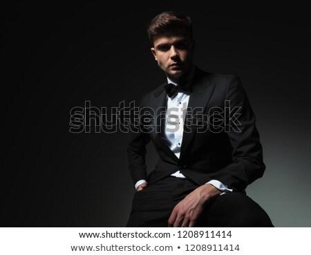 portré · ülő · elegáns · férfi · fekete · csokornyakkendő - stock fotó © feedough