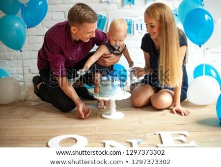 Parents are celebrating first birthday of their son and feeding  Stock photo © Stasia04