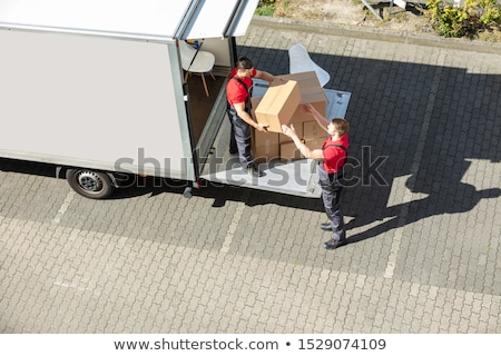 Male Movers Unloading The Cardboard Boxes Form Truck Stock photo © AndreyPopov