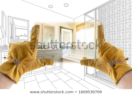 Male Contractor Hands Framing Completed Section of Bathroom Over Stock photo © feverpitch