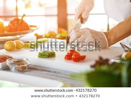 Chef cutting asparagus Stock photo © Kzenon
