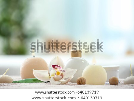 Spa composition with orchid flowers and lotions Stock photo © dashapetrenko