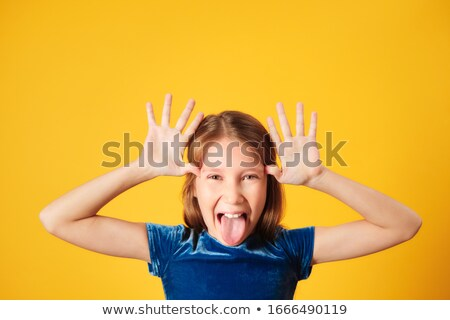 Young Redhead Preteen Girl Showing Tongue To Camera Stock photo © diego_cervo