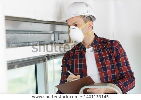 Man with a sander and a pen Stock photo © photography33
