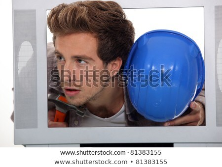 Man with a hard hat and hammer inside a TV set Stock photo © photography33