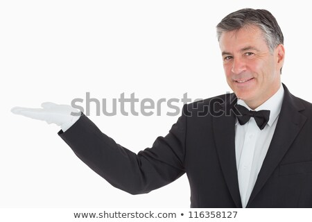 waiter in suit presenting us something stock photo © wavebreak_media