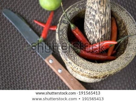 knife with chili pepper Stock photo © jirkaejc