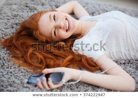 赤毛 女性 カーペット スマートフォン 美しい ホーム ストックフォト © deandrobot