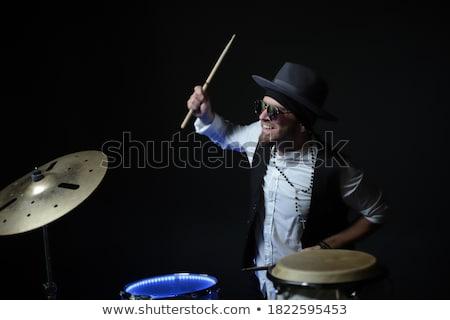 Portrait of musician sitting by drum kit Stock photo © wavebreak_media