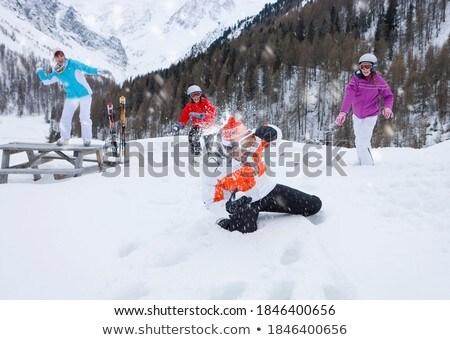 Lány térdel lefelé dob hó gyermek Stock fotó © IS2