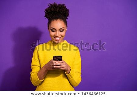 afro-amerikaanse · meisje · mobiele · telefoon · mooie · vrouw · krulhaar - stockfoto © NeonShot