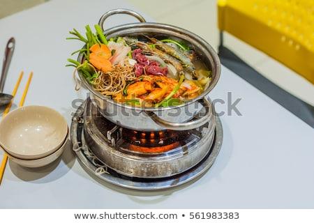 Vietnamese soup hot pot with shrimp, pork and sauerkraut Stock photo © galitskaya
