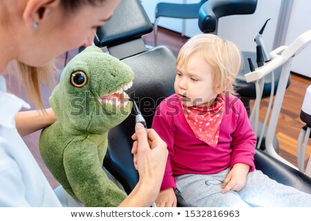 Child at the dentist brushing teeth of a plush toy Stock photo © Kzenon