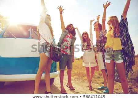 Smiling young women by the vintage minivan Stock photo © boggy