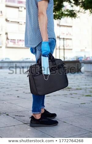 Homem luvas pasta máscara cirúrgica moço Foto stock © nito