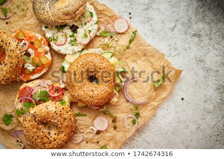 Tasty colorful various bagels with healthy ingredients served on brown baking paper Stock photo © dash