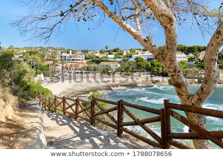 Empty pathway fenced with wooden railings lead to Benissa beach. Stock photo © amok