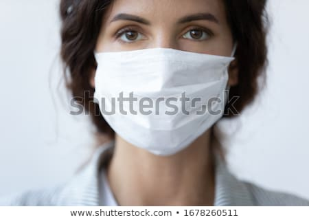 Coronavirus prevention doctor wearing preventive surgical face mask against coronavirus with COVID-1 Stock photo © Maridav