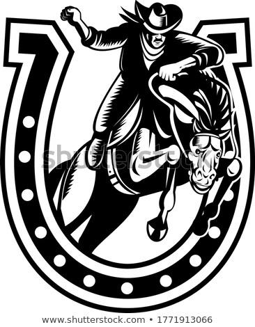 Rodeo Cowboy on Horseback Jumping Over Horseshoe Retro Woodcut Black and White Stock photo © patrimonio