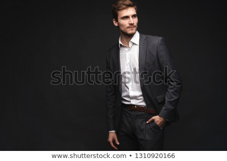 Young man in thoughtful pose. Isolated over white.  stock photo © dacasdo