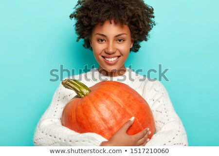 girl with pumkins stock photo © bananna