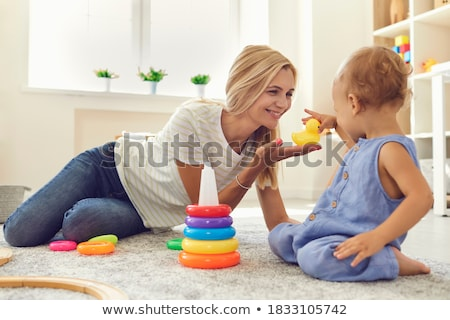 Stock photo: Childs hands taking the toy from his mother