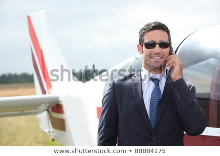 Man talking on a mobile phone next to a private plane Stock photo © photography33