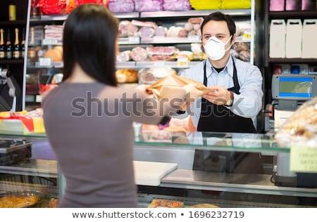 smiling retail salesman stock photo © lovleah