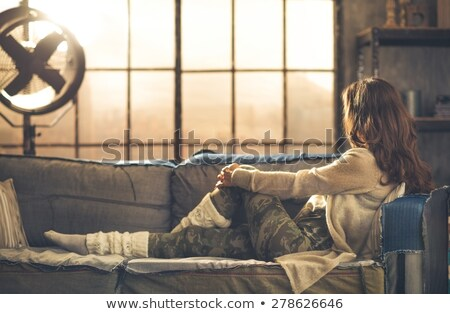 Chic woman sitting on a white sofa Stock photo © photography33
