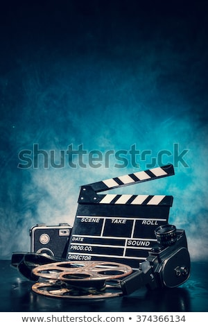cinema clapper and film tape Stock photo © AnatolyM