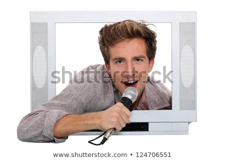 hombre · cantando · dentro · televisión · paisaje · cuadro - foto stock © photography33