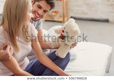 Kadın yatak oyuncak ayı yalıtılmış Stok fotoğraf © pekour