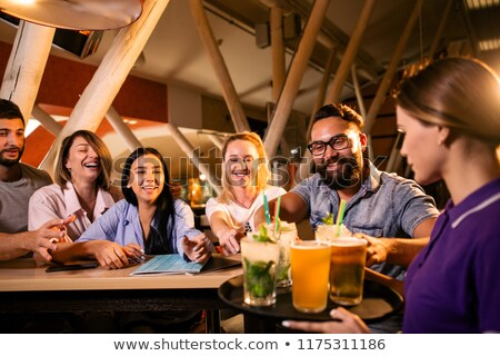 Waiter with tray and bottle of beer Stock photo © photography33