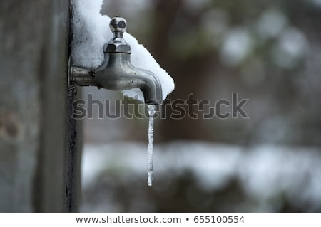 frozen water-tap on ice rock stock photo © pterwort